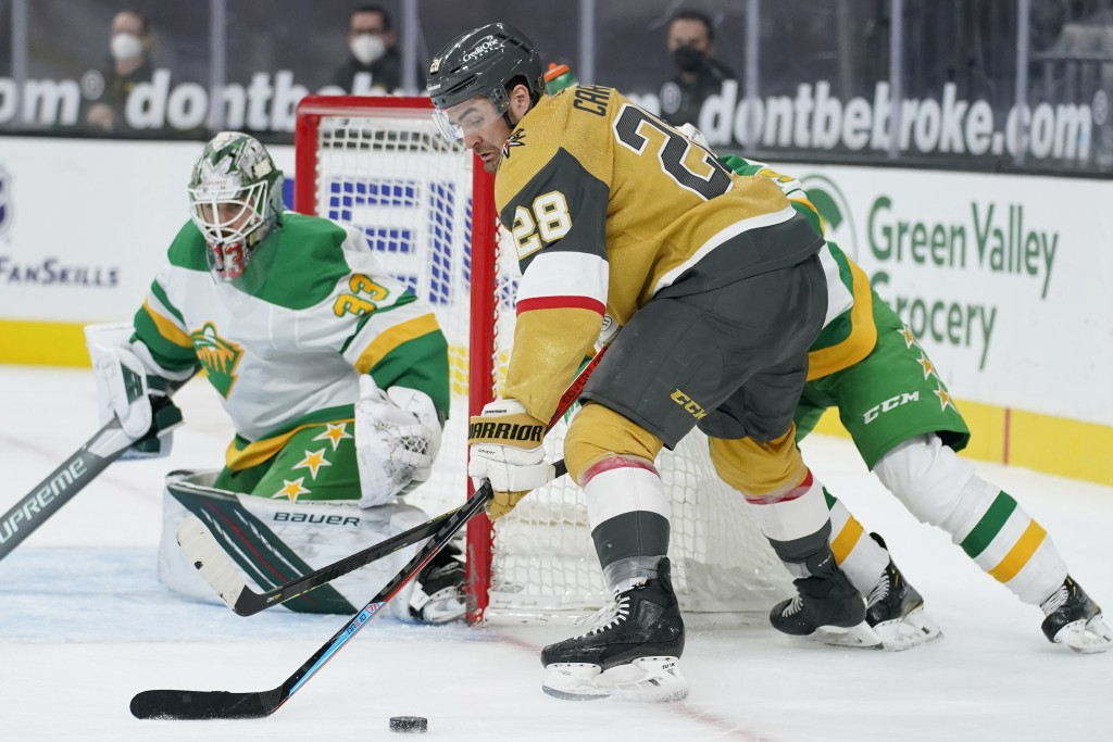 Vegas Golden Knights left wing William Carrier (28) looks to shoot against Minnesota Wild goaltender Cam Talbot (33) during the second period of an NH...