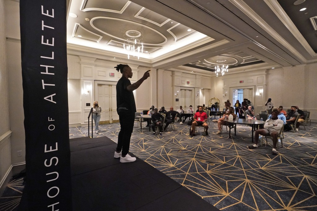 House of Athlete Scouting Combine founder and former NFL player Brandon Marshall, left, speaks as he kicks off the first day of the combine Wednesday,...