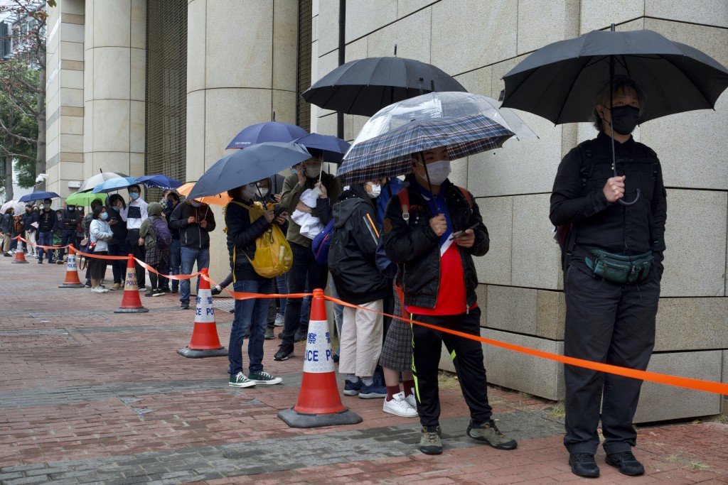 Supporters queue up for hearing outside a court in Hong Kong Thursday, March 4, 2021. A marathon court hearing for 47 pro-democracy activists in Hong ...