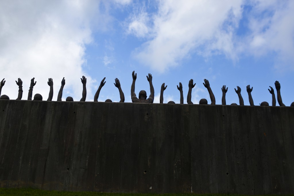 """FILE - In this April 23, 2018, file photo, is a bronze statue called """"Raise Up"""" that is part of the display at the National Memorial for Peace and Jus..."""