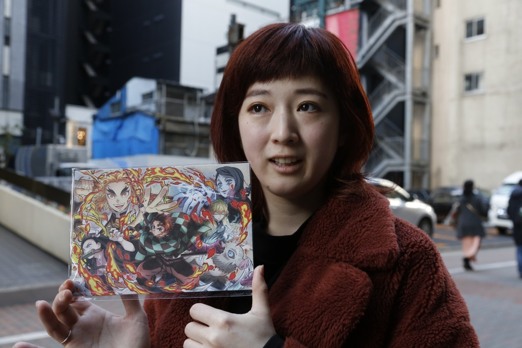 "Japanese hairstylist Akina Nasu shows a picture she got when she went to see the film ""Demon Slayer,"" which has become the nation's top-grossing film,..."