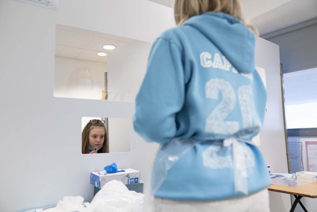 A student at Great Academy Ashton is taken through the Covid testing proceedure as the school prepares for its reopening on March 8 after the latest l...