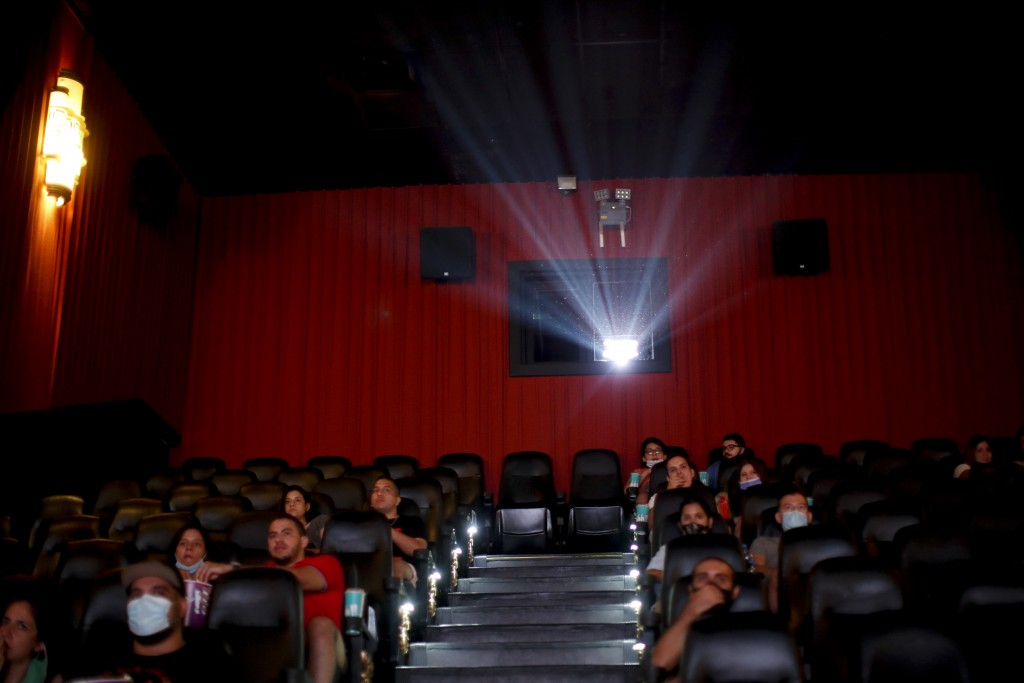 People watch a movie at a cinema after almost a year of theaters being closed due to the COVID-19 pandemic, in Buenos Aires, Argentina, Wednesday, Mar...