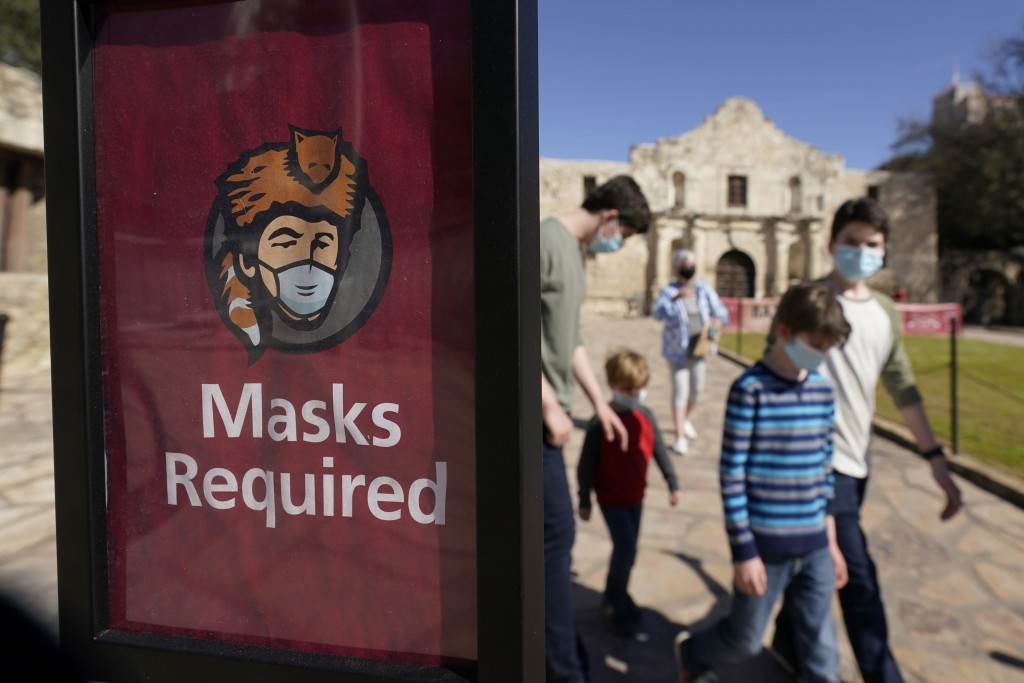 Visitors wearing face masks leave the Alamo, Wednesday, March 3, 2021, in San Antonio. Gov. Greg Abbott says Texas is lifting a mask mandate and lifti...