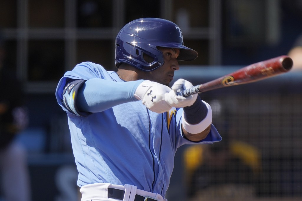Tampa Bay Rays' Wander Franco, hits a home run in the second inning during a spring training baseball game against the Pittsburgh Pirates on Wednesday...