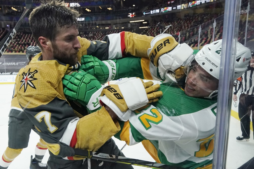 Vegas Golden Knights defenseman Alex Pietrangelo (7) and Minnesota Wild left wing Kevin Fiala (22) fight during the third period of an NHL hockey game...
