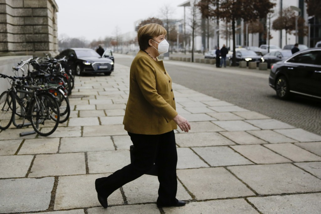 German Chancellor Angela Merkel leaves the German Parliament Bundestag after a debate about the coronavirus outbreak situation, in Berlin, Germany, Th...