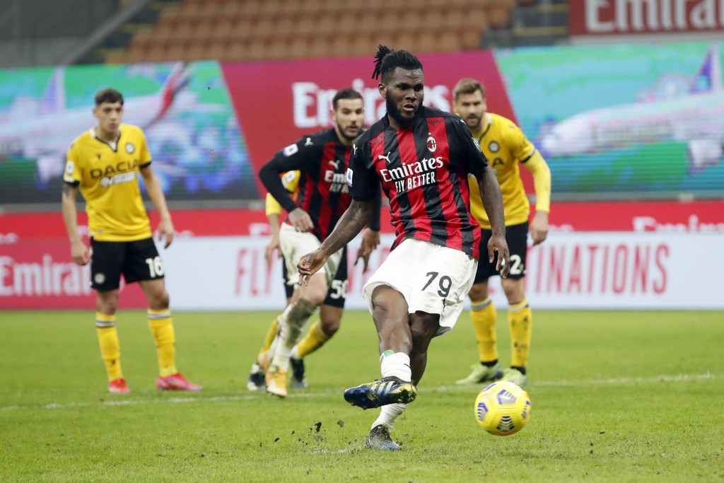 AC Milan midfielder Franck Kessie (79) scores the penalty spot during the Serie A soccer match between AC Milan and Udinese at the San Siro stadium, i...