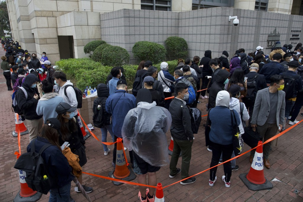 Supporters queue up for a hearing outside a court in Hong Kong Thursday, March 4, 2021. A marathon court hearing for 47 pro-democracy activists in Hon...