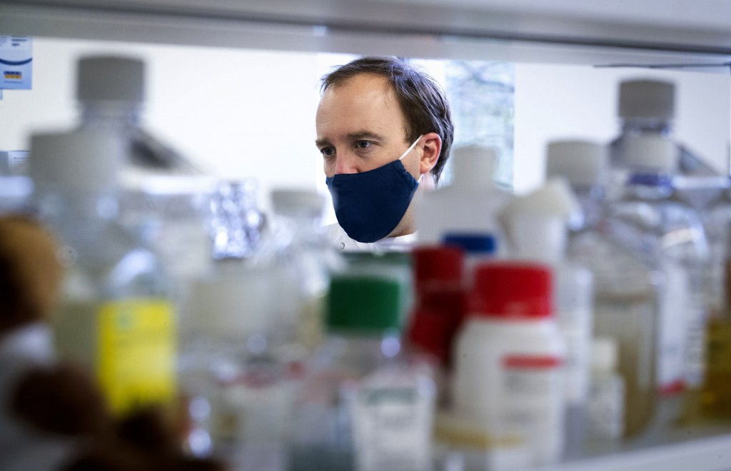 Britain's Health Secretary Matt Hancock during a visit to the Centre for Virus Research at Glasgow University in Glasgow, Scotland, Thursday March 4, ...