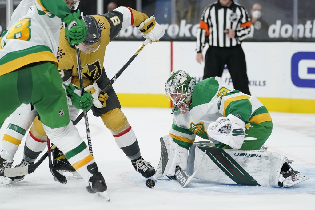 Minnesota Wild goaltender Cam Talbot (33) stops an attempted shot by Vegas Golden Knights center Cody Glass (9) during the second period of an NHL hoc...