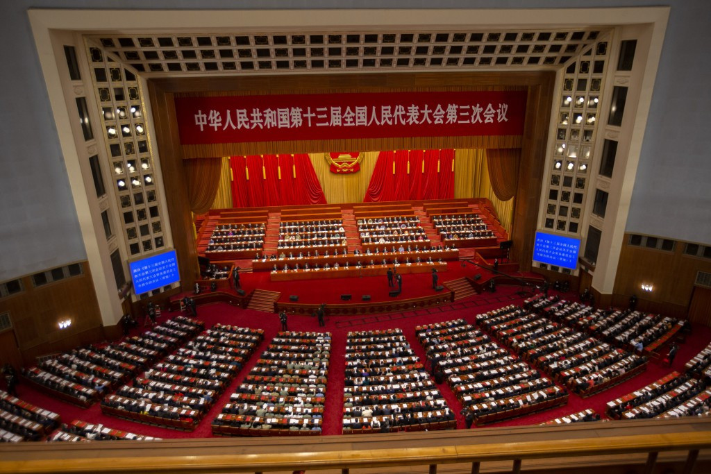 FILE - In this May 28, 2020, file photo, delegates and Chinese leaders attend the closing session of China's National People's Congress (NPC) ...