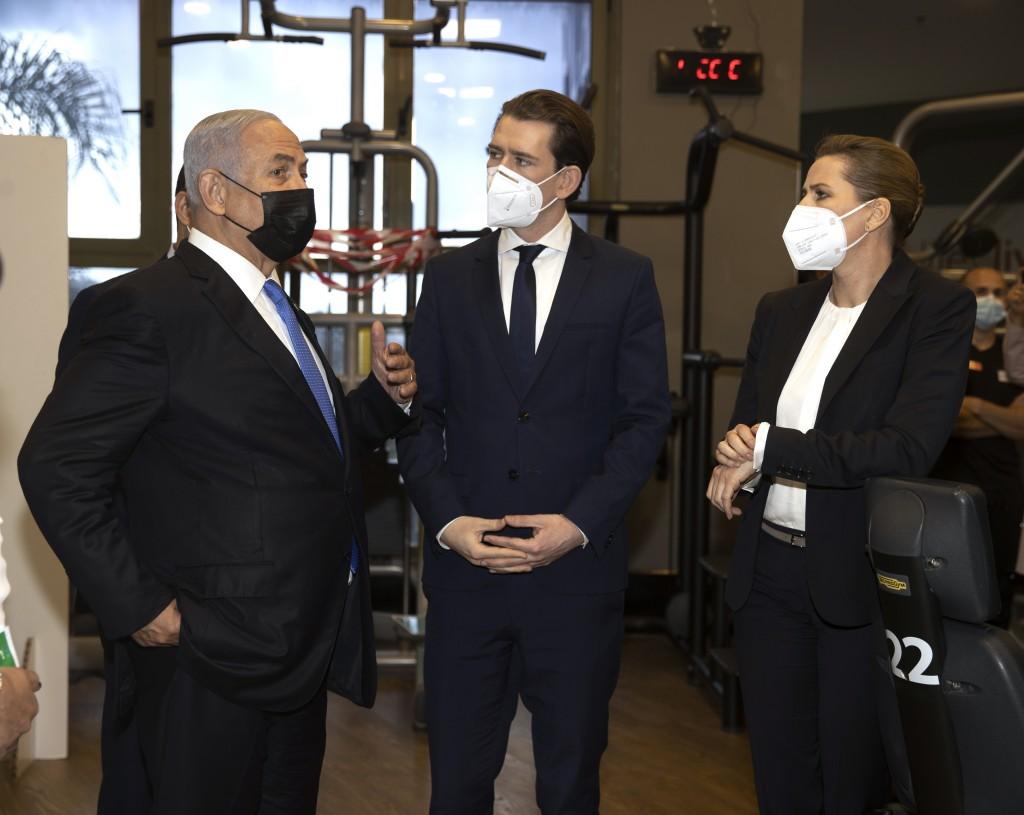 Israeli Prime Minister Benjamin Netanyahu, left, visits a fitness gym with Austrian Chancellor Sebastian Kurz, center, and Danish Prime Minister Mette...