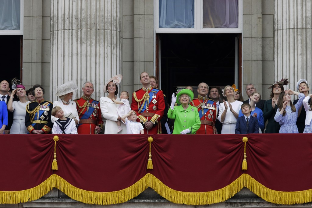 FILE - In this June 11, 2016 file photo, Britain's Queen Elizabeth II waves as she watches the flypast, with Prince Philip, to right, Prince William, ...
