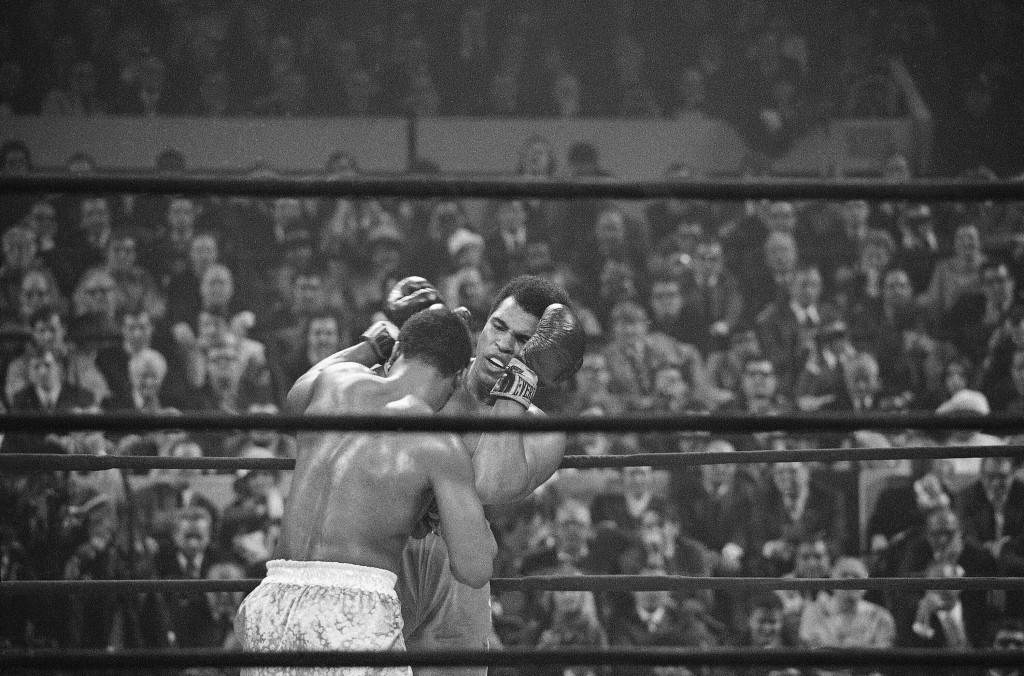 FILE - In this March 8, 1971 file photo, Joe Frazier, left, faces off against Muhammad Ali, right, on the ropes during the fourth round of their heavy...