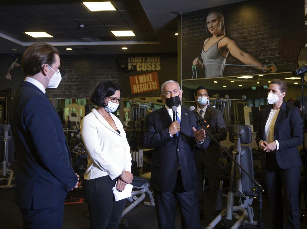 Israeli Prime Minister Benjamin Netanyahu, center, visits a fitness gym with Austrian Chancellor Sebastian Kurz, left, and Danish Prime Minister Mette...