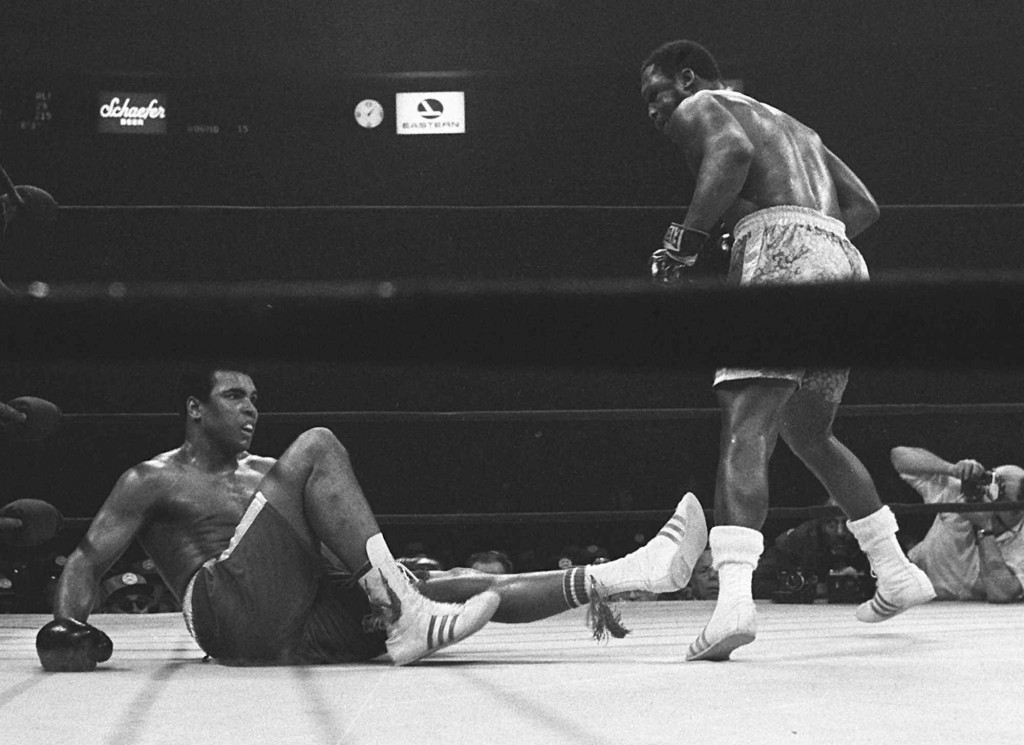FILE - Joe Frazier stands over Muhammad Ali in the 15th round of their boxing match at Madison Square Garden in New York, in this March 8, 1971, file ...