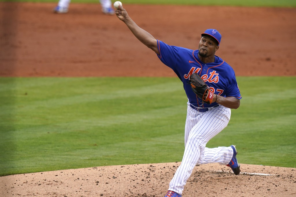 New York Mets relief pitcher Jeurys Familia throws during the third inning of a spring training baseball game against the Washington Nationals, Thursd...