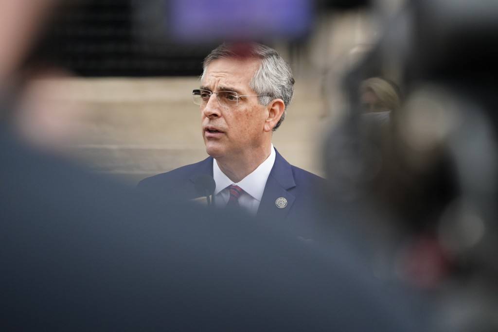 FILE - In this Wednesday, Nov. 11, 2020, file photo, Georgia Secretary of State Brad Raffensperger speaks during a news conference in Atlanta, announc...