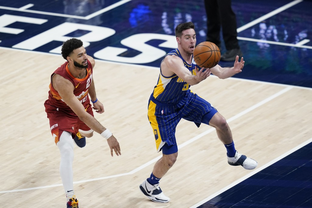 Indiana Pacers' T.J. McConnell (9) tries to steal the ball from Denver Nuggets' Jamal Murray (27) during the first half of an NBA basketball game, Thu...