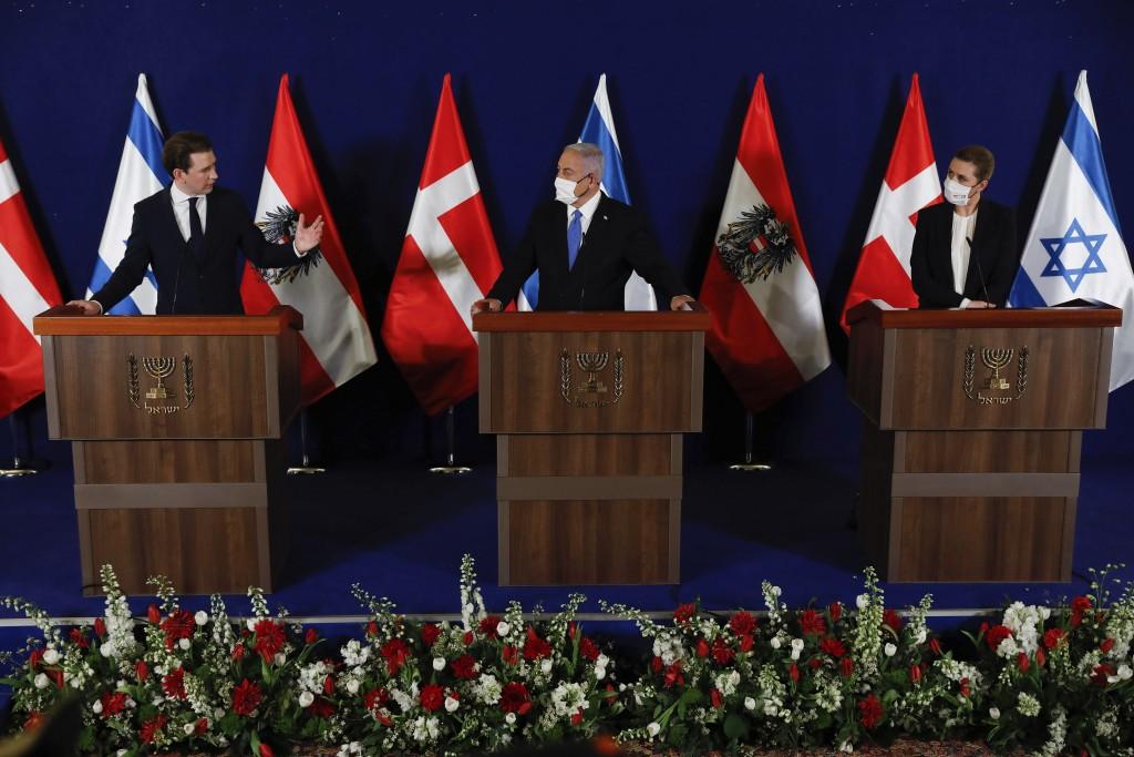 Israeli Prime Minister Benjamin Netanyahu, center, Danish Prime Minister Mette Frederiksen, left, and Austrian Chancellor Sebastian Kurz, right, speak...