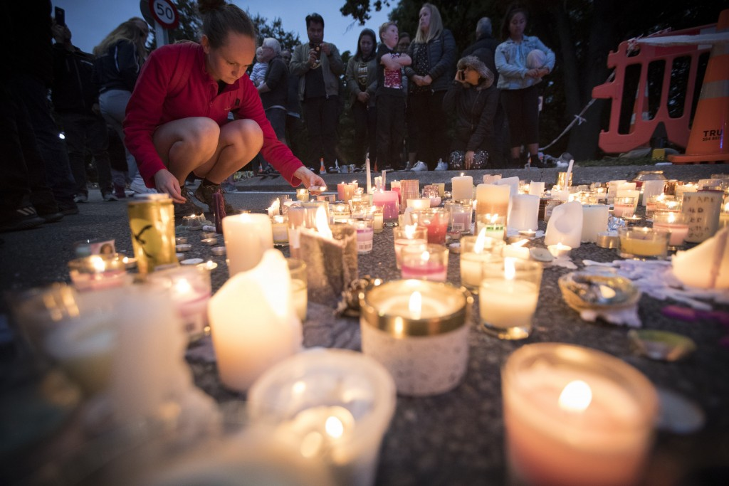 FILE - In this March 18, 2019, file photo, candles are placed to commemorate victims of Friday's shooting, outside the Al Noor mosque in Christchurch,...