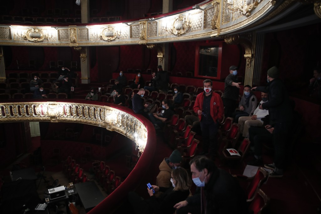 Out-of-work French culture and tourism workers occupy the iconic Odeon theater, Friday, March 5, 2021 in Paris. Out-of-work French culture and tourism...