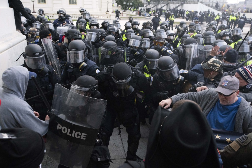 FILE - In this Jan. 6, 2021, file photo, U.S. Capitol Police push back rioters trying to enter the U.S. Capitol in Washington. Hundreds of emails, tex...
