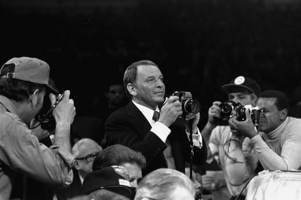 FILE - Frank Sinatra is photographed as he takes pictures at the Joe Frazier vs Muhammad Ali boxing match at Madison Square Garden in New York, in thi...