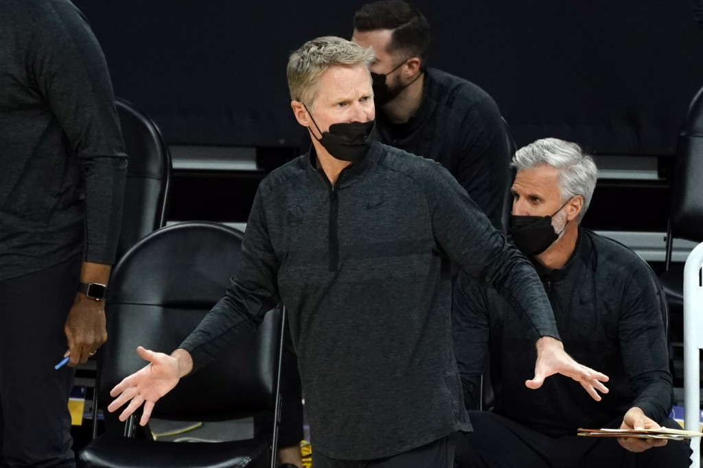 Golden State Warriors head coach Steve Kerr reacts to a call during the first half of an NBA basketball game against the Phoenix Suns, Thursday, March...