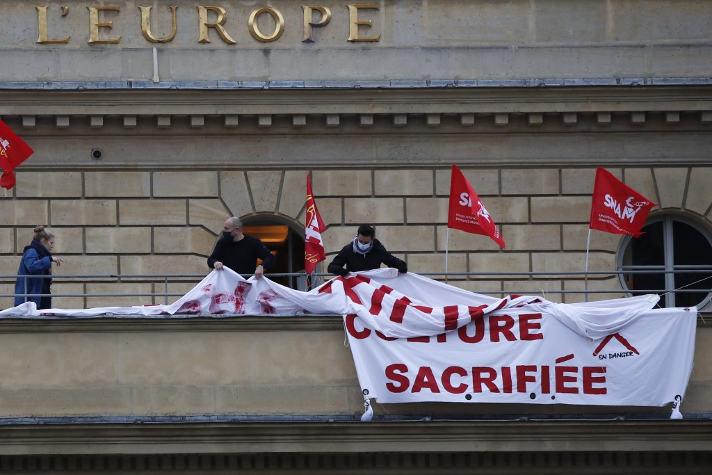 "Out-of-work French culture and tourism workers display a banner reading "" Culture Sacrificed"" as they occupy the iconic Odeon theater, Friday, March 5..."