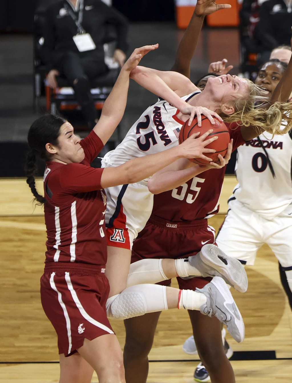 Arizona forward Cate Reese (25) shoots as Washington State guard Charlisse Leger-Walker (5) defends during the first half of an NCAA college basketbal...