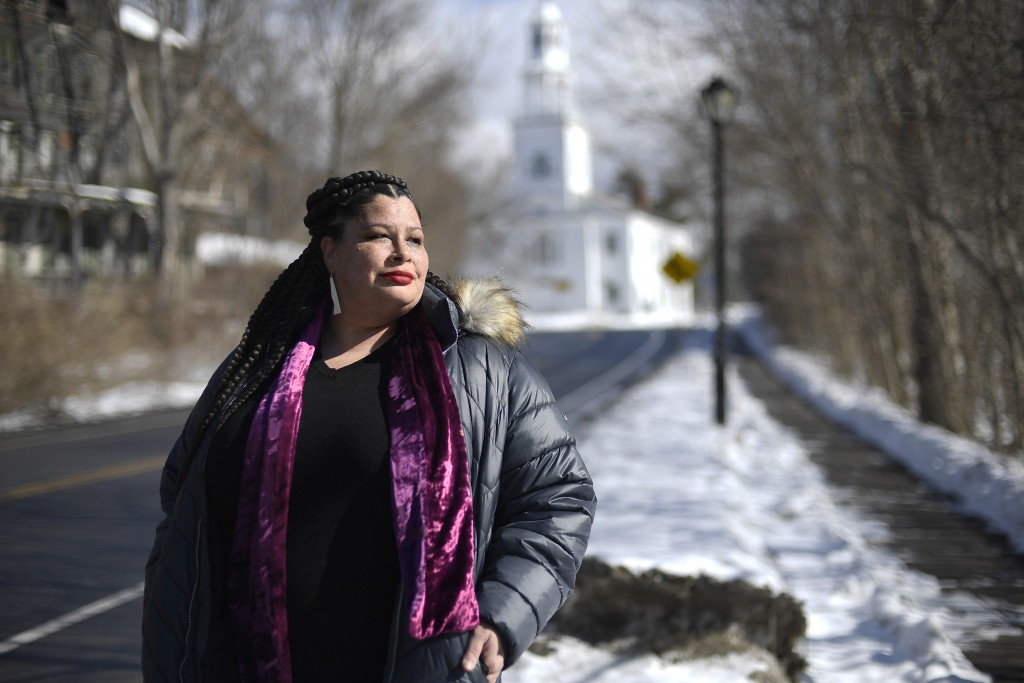 In this Saturday, Feb. 20, 2021, photo, Mia Schultz, president of the Rutland area branch of the NAACP, poses for a picture, in Bennington, Vt. Schult...