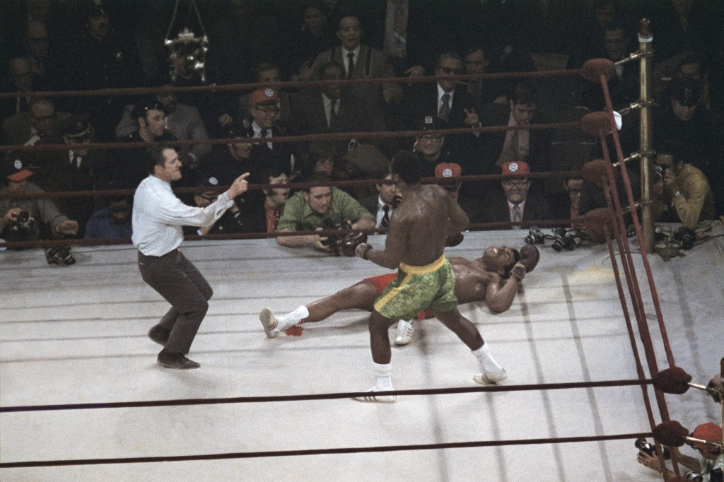 FILE - Joe Frazier stands over Muhammad Ali as referee Art Mercante gestures in the 15th round of their boxing match at Madison Square Garden in New Y...