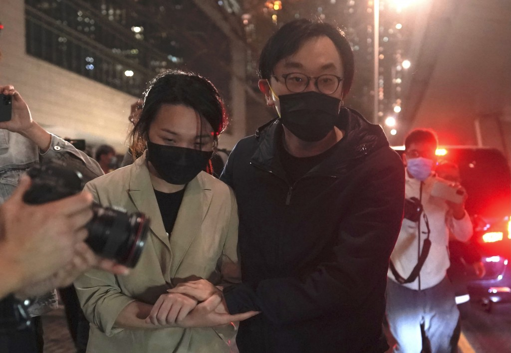 Mike Lam and his wife leave after he was released on bail at a court in Hong Kong, Friday, March 5, 2021. Four of the 47 pro-democracy activists charg...