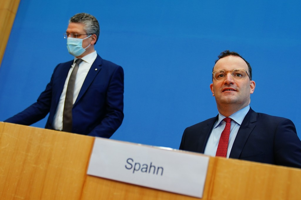 Lothar Wieler, left, president of the Robert Koch Institute (RKI), and German Health Minister Jens Spahn, right, arrive for a press conference in Berl...
