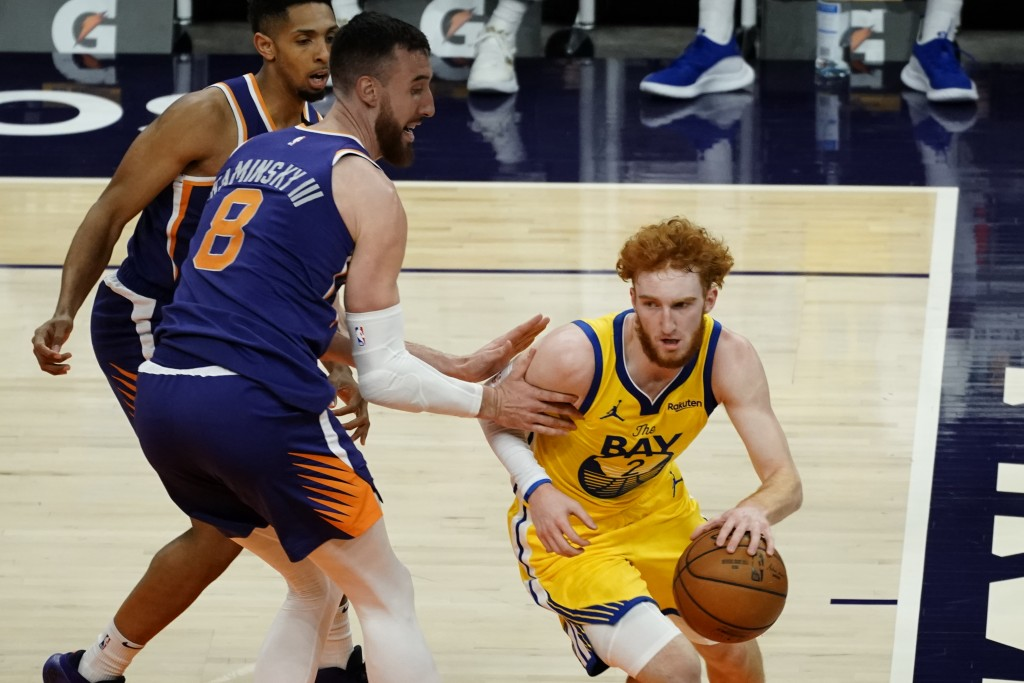 Golden State Warriors guard Nico Mannion (2) drives past Phoenix Suns forward Frank Kaminsky (8) during the first half of an NBA basketball game, Thur...