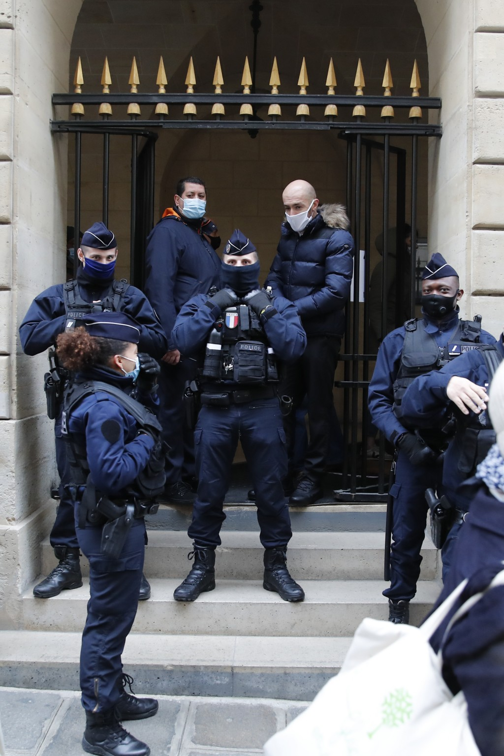 Police officers control the entrance of the occupied iconic Odeon theater, Friday, March 5, 2021 in Paris. Out-of-work French culture and tourism work...