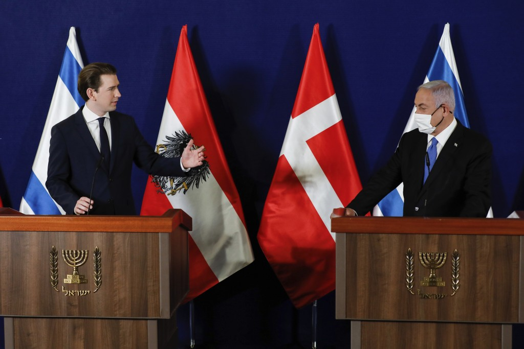 Israeli Prime Minister Benjamin Netanyahu, right, speaks during a joint statement with the Austrian Chancellor Sebastian Kurz, left,  and the Danish P...