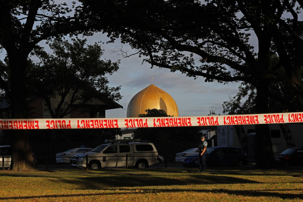 FILE - In this March 17, 2019, file photo,  police officer stands guard in front of the Masjid Al Noor mosque in Christchurch, New Zealand, where one ...