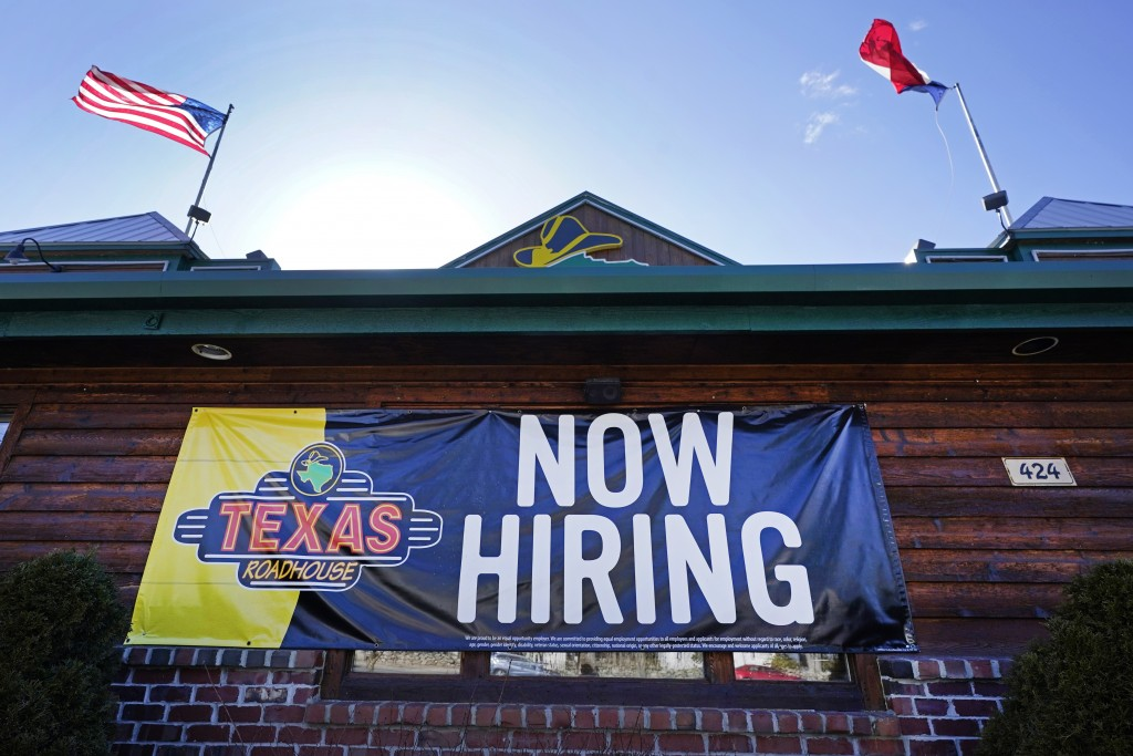 "A restaurant displays a ""Now Hiring"" sign, Thursday, March 4, 2021, in Methuen, Mass.  The American job market delivered a surprising burst of strengt..."