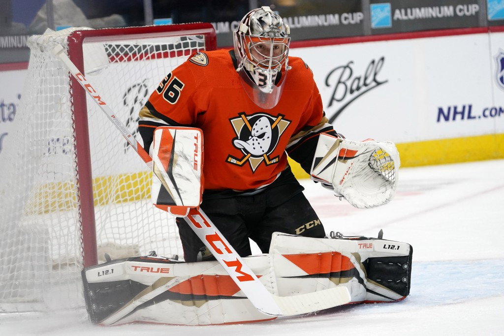 Anaheim Ducks goaltender John Gibson looks to stop a shot by the Colorado Avalanche in the first period of an NHL hockey game Friday, March 5, 2021, i...
