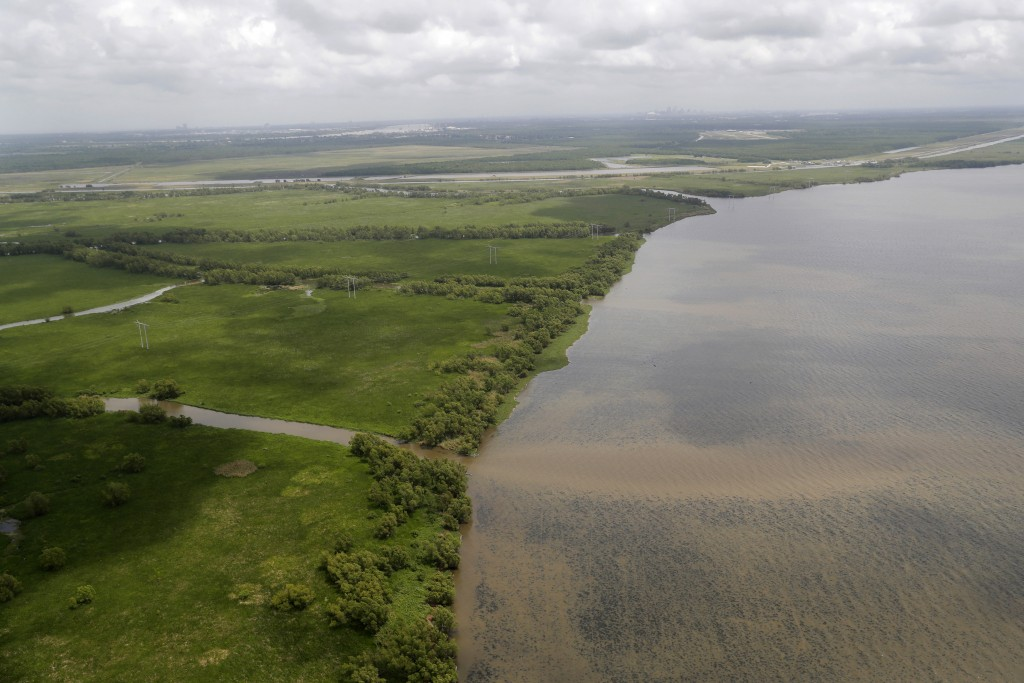 FILE - This May 1, 2019, file photo shows the Davis Pond Diversion emptying into Lake Cataouache, with tree growth on the edges of the channels in St....