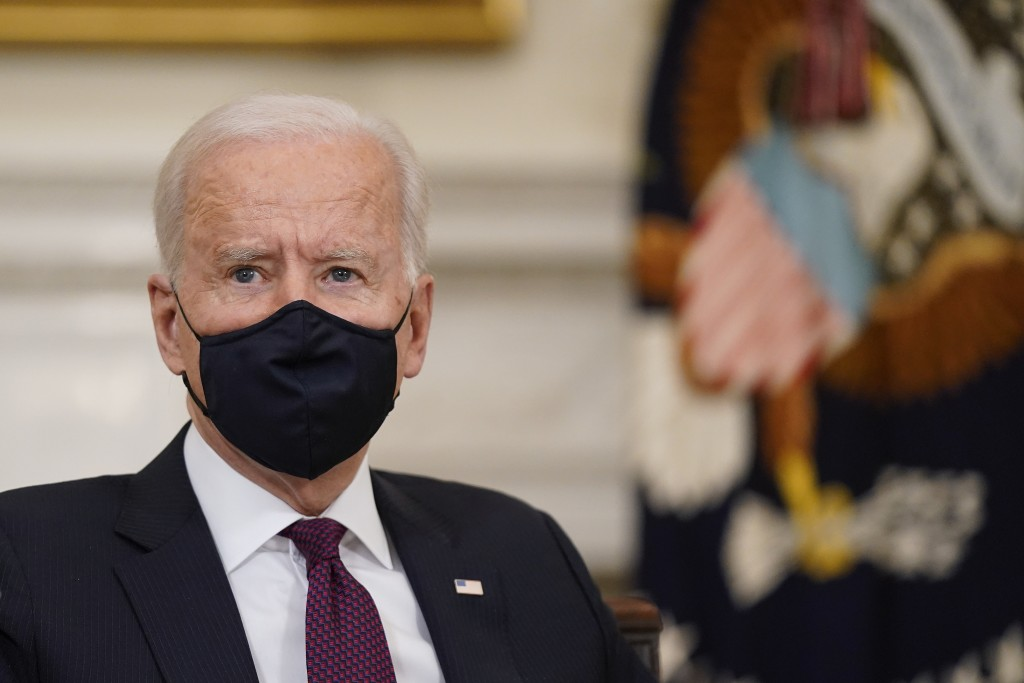 President Joe Biden participates in a roundtable discussion on a coronavirus relief package in the State Dining Room of the White House in Washington,...