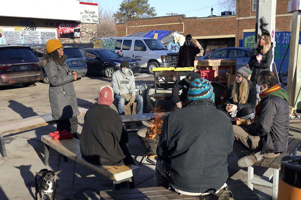 Marcia Howard, left, a group organizer, addresses activists and neighbors at George Floyd Square, March 4, 2021, in Minneapolis. Ten months after poli...