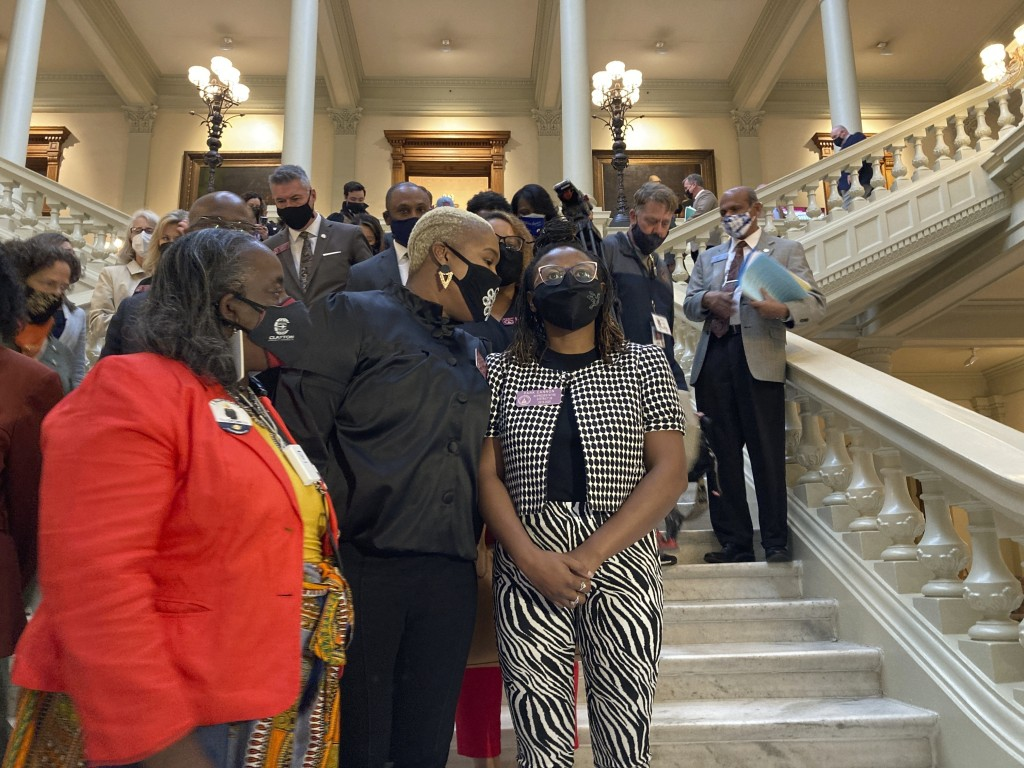FILE - In this Friday, Feb. 26, 2021 file photo, Georgia House Democrats speak with Democratic Rep. Park Cannon, right, in Atlanta during a sit-in at ...