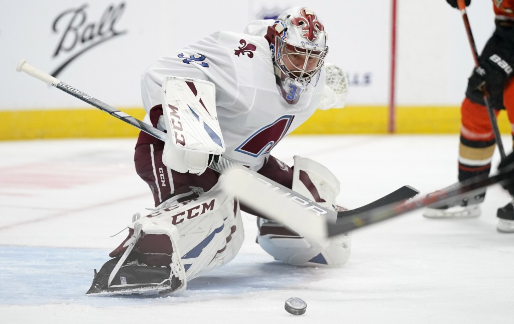 Colorado Avalanche goaltender Philipp Grubauer looks to stop a shot by the Anaheim Ducks in the second period of an NHL hockey game Friday, March 5, 2...