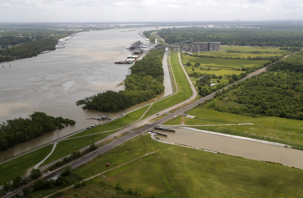 FILE - This May 1, 2019, file photo, shows the Davis Pond Diversion, a project that diverts water from the Mississippi River, left, into the Barataria...