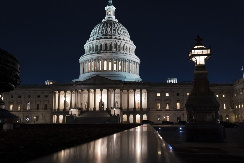 The Capitol is seen at dusk as work in the Senate is stalled on the Democrats' $1.9 trillion COVID-19 relief bill, in Washington, Friday, March 5, 202...