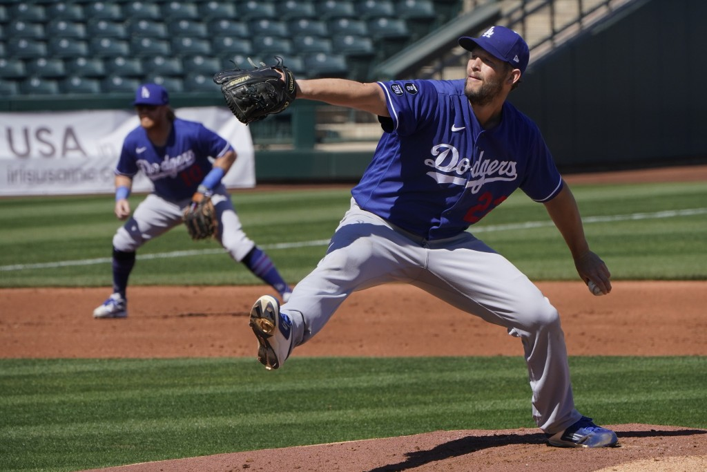 Los Angeles Dodgers' Clayton Kershaw (22) pitches in the first inning of a spring training baseball game against the Kansas City Royals, Friday, March...